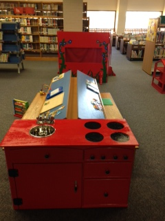 Puppet theatre and play kitchen made under the leadership of Eagle Scout, Austin Molitor for the Mounce Library  Early Literacy Space